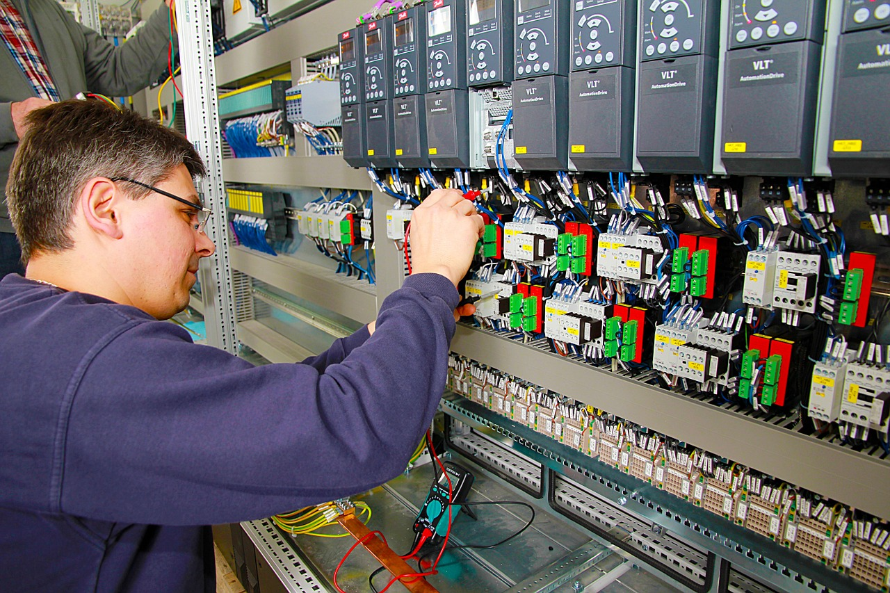 Technician working on control cabinet